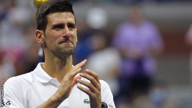 Novak Djokovic applauds the New York audience