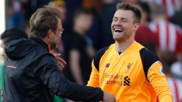 Liverpool goalkeeper Simon Mignolet (right) at the end of his side's win at Stoke City with manager Jurgen Klopp