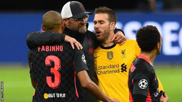 Jurgen Klopp celebrating with Adrian and Fabinho
