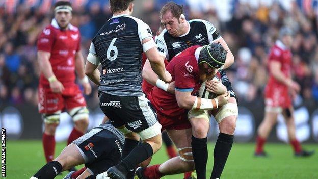 Jake Ball tackled by Alun Wyn Jones