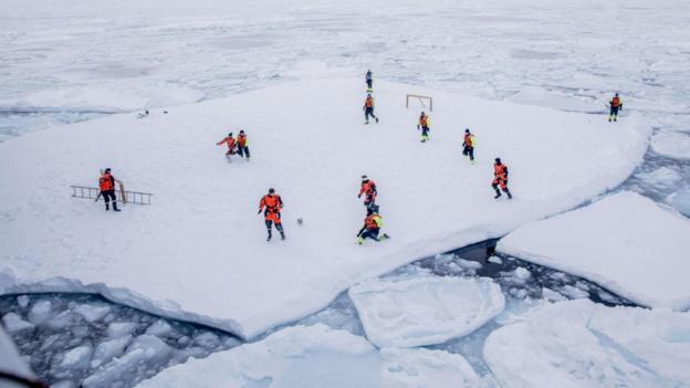 Norwegian Coast Guard of crew members of Norwegian Coast Guard icebreaker KV Svalbard getting a once in a lifetime experience while playing soccer on an ice floe in the arctic environment in the sea around 2018 (issued 28 March 2018)