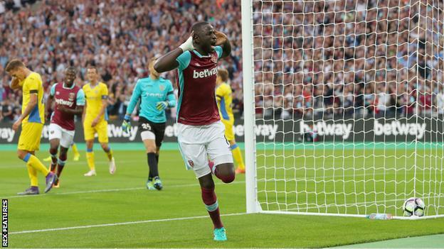 Cheikhou Kouyate celebrates scoring against NK Domzale in the Europa League