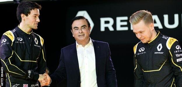 Jolyon Palmer and Kevin Magnussen shake hands with Renault president Carlos Ghosn