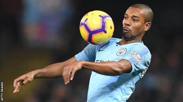 Fernandinho in action for Manchester City against Liverpool