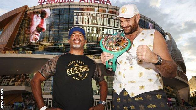 Tyson Fury grins beside his trainer Sugarhill Steward