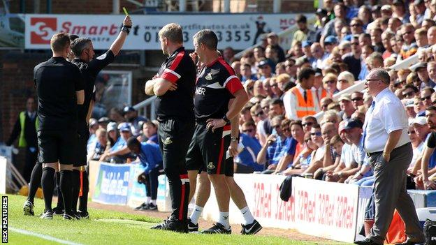 Steve Evans shown a second yellow card on touchline for Peterborough v Doncaster