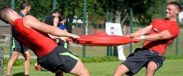 Rhys Priestland and Hallam Amos tussle in training