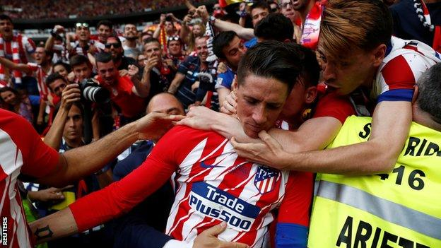 Fernando Torres celebrates his second goal with Atletico Madrid fans