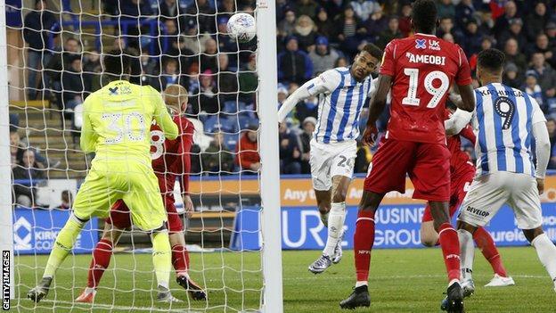 Steve Mounie powers in Huddersfield's second goal