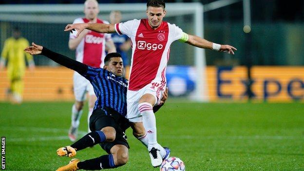 Remo Freuler tackles Ajax's Dusan Tadic in a Champions League game