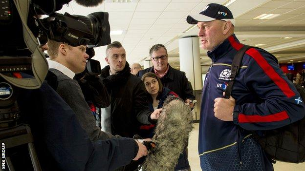 Vern Cotter talks to reporters at Edinburgh Airport