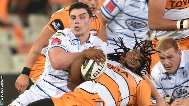 Joseph Dweba is brought down by Seb Davies