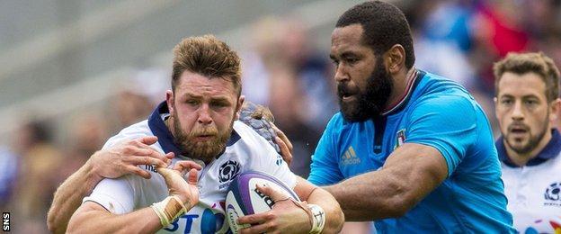 Samuela Vunisa of Italy tackles Scotland's Ryan Wilson