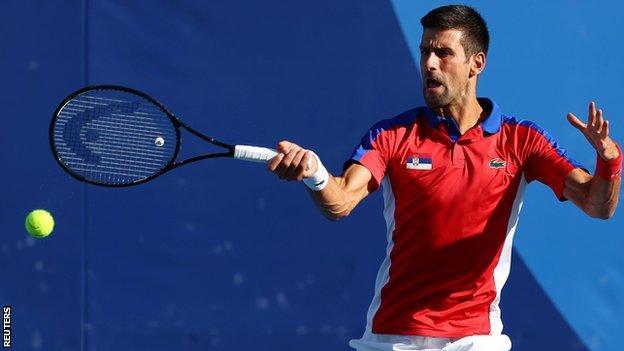 Novak Djokovic returns a ball in his third-round match at the Tokyo Olympics