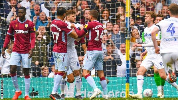 Villa players grabbed hold of Mateusz Klich following his controversial opening goal at Elland Road