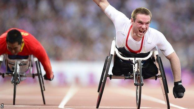 Mickey Bushell celebrates after taking the gold medal in the men's 100m T53 at the London Paralympics in 2012