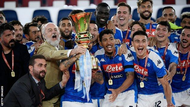 Napoli president and owner Aurelio de Laurentiis celebrates with his players after winning the Coppa Italia