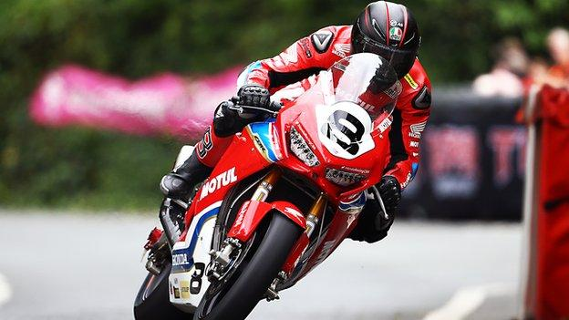 Guy Martin crashed out of the opening Superbike race at the TT races