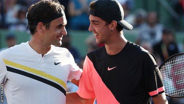 Kokkinakis (right) beats Federer