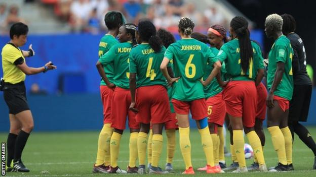 Cameroon players protest in the middle of the pitch