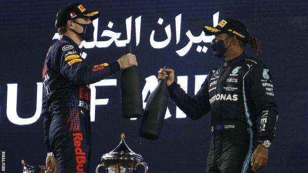 Max Verstappen and Lewis Hamilton on the podium