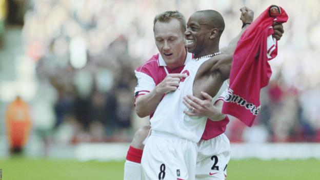 Ian Wright celebrates scoring a goal for Arsenal