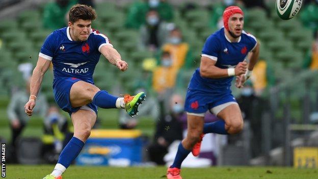 France's Matthieu Jalibert kicks the ball