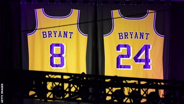The number 8 and number 24 retired Kobe Bryant Los Angeles Lakers jerseys hanging in the rafters of the Staples Center