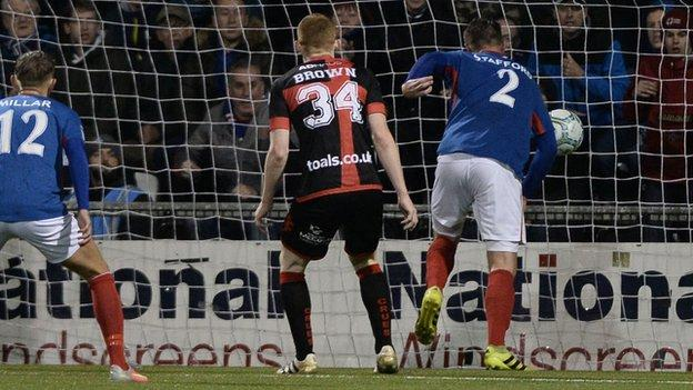 Mark Stafford pulls one back for Linfield but Crusaders prevailed in north Belfast