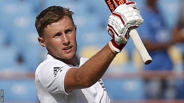 Joe Root celebrates reaching his century in the first Test against India