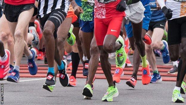 General shot of people running