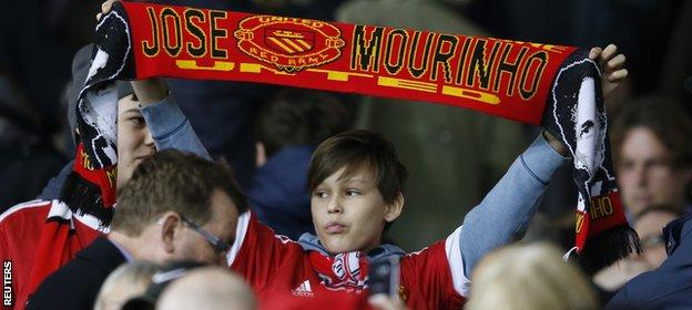 Jose Mourinho scarf held by a Man Utd fan