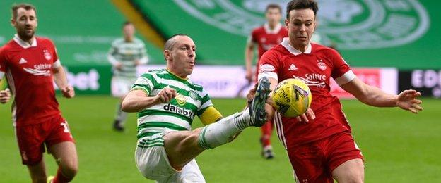 Scott Brown vies for possession with Aberdeen's Andrew Considine