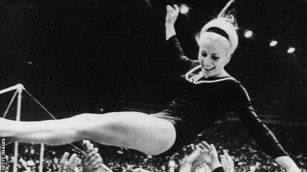 Vera Caslavska being lifted in the air