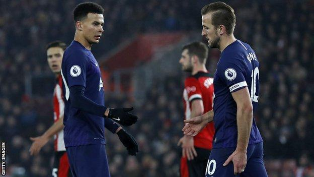 Harry Kane holds his hamstring as he walks off injured against Southampton