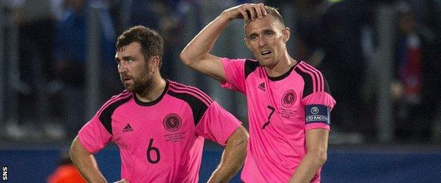 Scotland's James McArthur and Darren Fletcher show their frustration against France