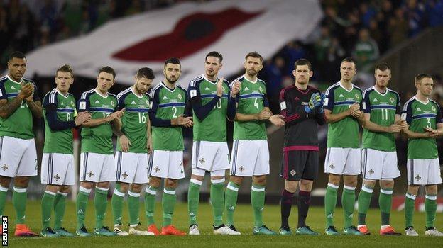 Northern Ireland players wore plain black armbands