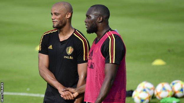 Belgium team-mates Vincent Kompany (left) and Romelu Lukaku