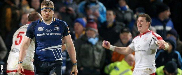 Ulster's Dan Tuohy and Craig Gilroy celebrate behind despondent Leinster captain Jamie Heaslip