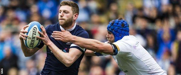 Finn Russell in action for Scotland against Italy
