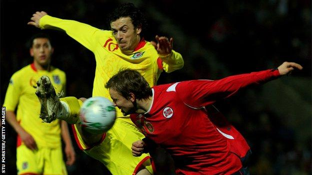 Wales captain Simon Davies clears the ball from Norway striker Erik Nevland during the International Friendly Match at The Racecourse Ground on February 6, 2008 in Wrexham
