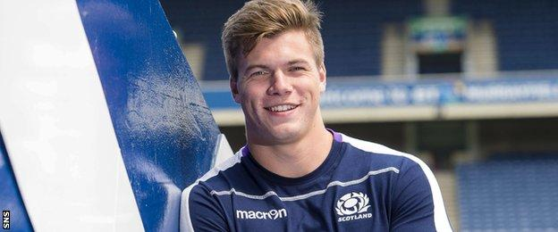Huw Jones poses for pictures at Murrayfield