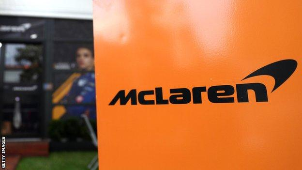 The McLaren logo on a sign at a Formula 1 Grand Prix