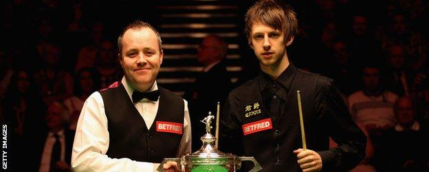 Judd Trump and John Higgins in 2011 with the trophy
