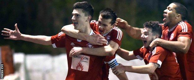 Stuart McMullan celebrates after putting Larne ahead at Inver Park