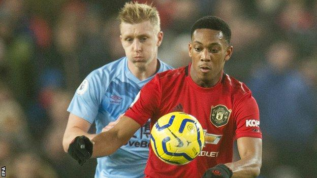 Burnley's Ben Mee and Manchester United's Anthony Martial