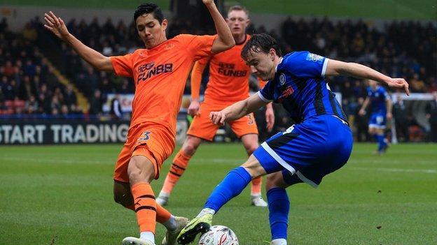 Newcastle's Yoshinori Muto and Oliver Rathbone of Rochdale battle for possession
