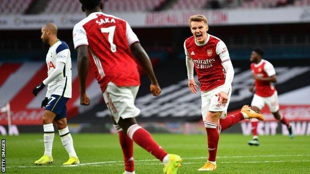 Martin Odegaard celebrates scoring against Tottenham