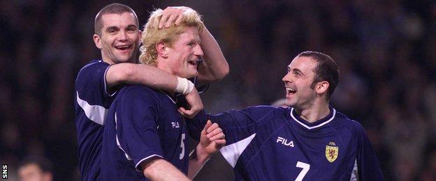 Scotland's Dominic Matteo, Colin Hendry and Colin Cameron celebrate against San Marino
