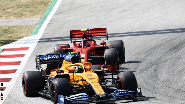 sports McLaren driver Lando Norris (left)